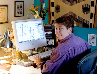 Holly Fischer, medical illustrator, working at her computer